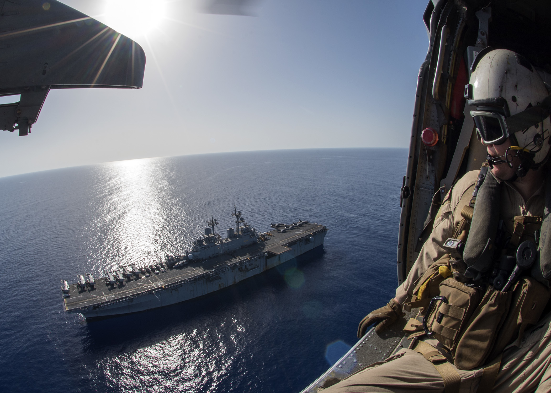 Petty Officer 1st Class Matthew Estep watches the amphibious assault ship USS Wasp (LHD 1) transit the Mediterranean Sea. US Navy photo.