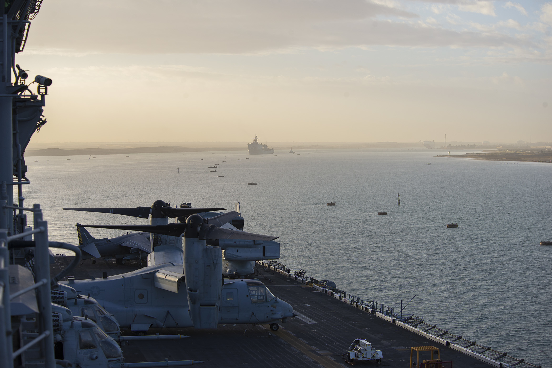 The amphibious transport dock ship USS Whidbey Island (LSD 41), background, and the amphibious assault ship USS Wasp (LHD 1) transit the Suez Canal on Dec. 1, 2016. US Navy photo.