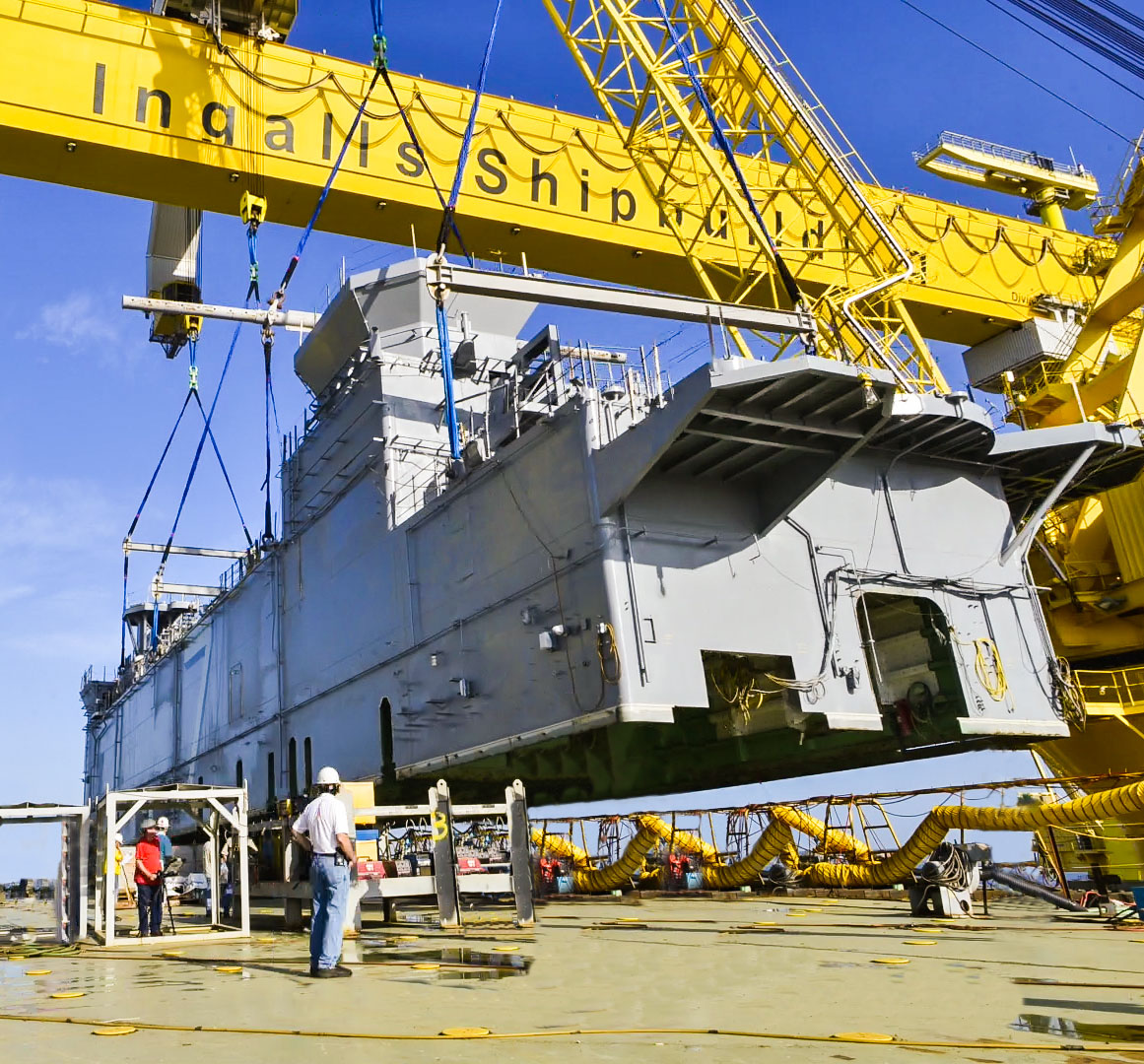 Ingalls Shipbuilding lands the 700-ton deckhouse on the amphibious assault ship Tripoli (LHA 7) on July 9, 2016. Ingalls Shipbuilding photo.