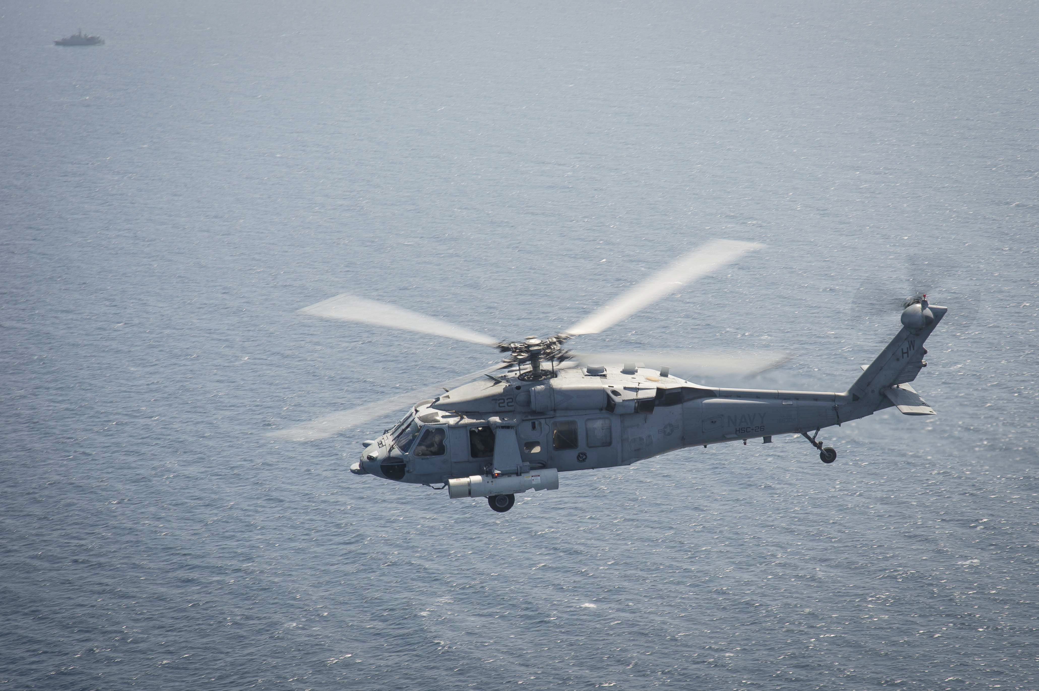 An MH-60S Sea Hawk helicopter from the Laser Hawks of Helicopter Sea Combat Squadron (HSC) 26, Detachment 2, equipped with the Airborne Laser Mine Detection System (ALMDS) conducts flight operations in August 2014. US Navy photo.