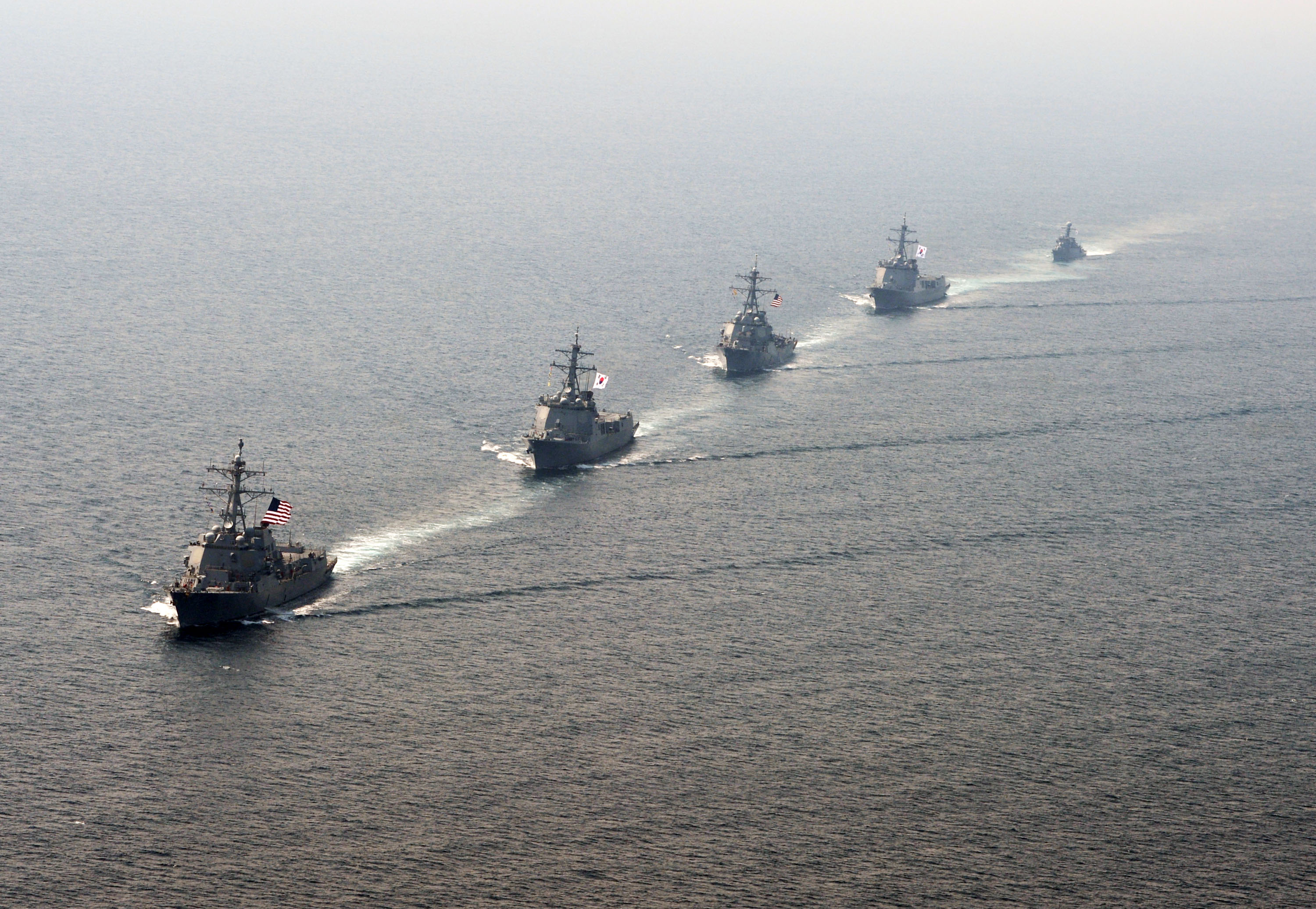 The guided-missile destroyer USS Momsen (DDG 92), left, Republic of Korea destroyer ROKS Seoae Ryu Seong-ryong (DDG-993), guided-missile destroyer USS Decatur (DDG 73), Republic of Korea destroyer ROKS Yulgok Yi (DDG-992) and Republic of Korea patrol craft ROKS Kwang Myung (PCC-782) steam in formation during a bilateral maneuvering exercise near the Korean Peninsula on May 21, 2016. US Navy photo.