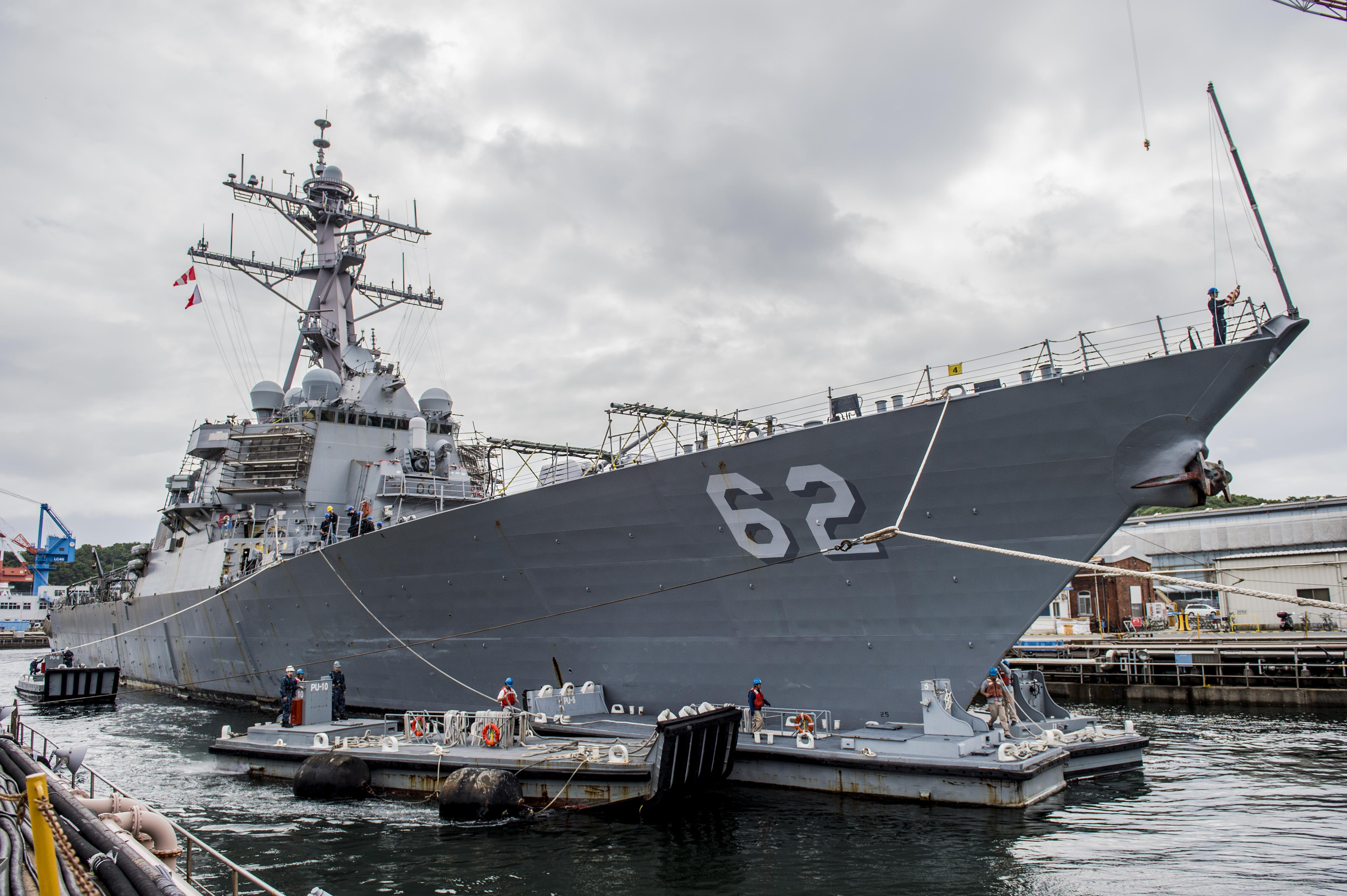 The Arleigh Burke-class guided-missile destroyer USS Fitzgerald (DDG 62) pulls into Dry Dock 5 at Naval Ship Repair Facility and Japan Regional Maintenance Center (SRF JRMC) Yokosuka on June 15, 2016. US Navy photo.