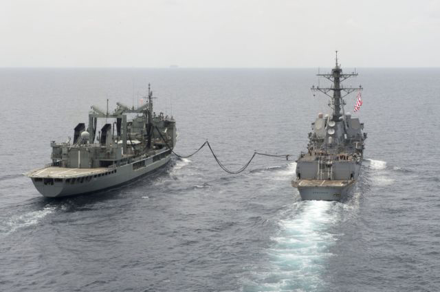 The guided-missile destroyer USS Spruance (DDG 111) takes on a fuel line from the Australian oiler HMAS Success (OR 304) during a refueling at sea on July 27, 2016. Spruance, along with the guided-missile destroyers USS Momsen (DDG 92) and USS Decatur (DDG 73), are deployed in support of maritime security and stability in the Indo-Asia-Pacific as part of a U.S. 3rd Fleet Pacific Surface Action Group (PAC SAG) under Commander, Destroyer Squadron (CDS) 31. US Navy photo.
