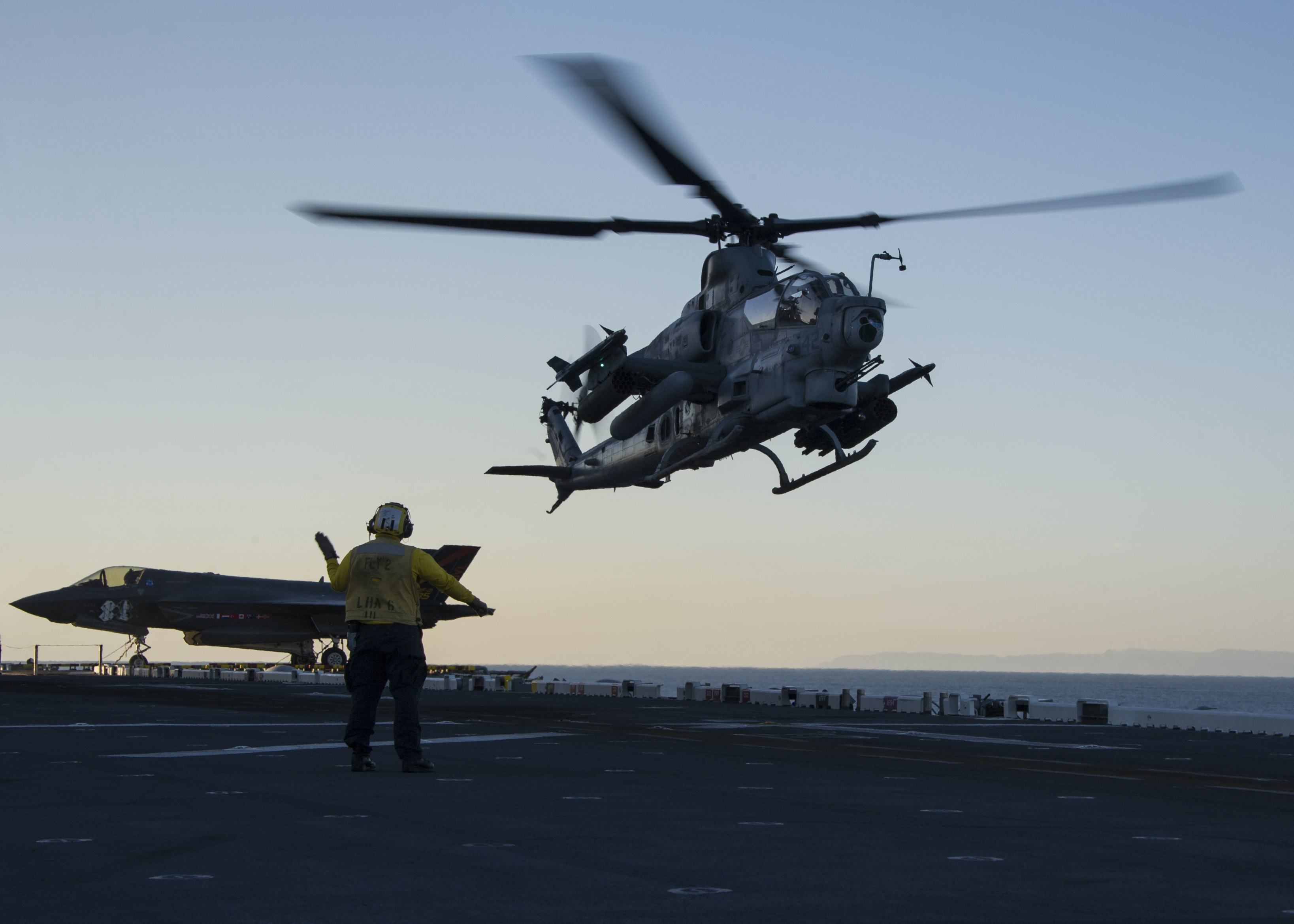 An AH-1Z Viper Attack Helicopter assigned to Marine Operational Test and Evaluation Squadron 1 (VMX-1) takes off from the flight deck of amphibious assault ship USS America (LHA-6) as part of the air wing including F-35B Lightning II aircrafts on Nov. 17, 2016. US Navy Photo