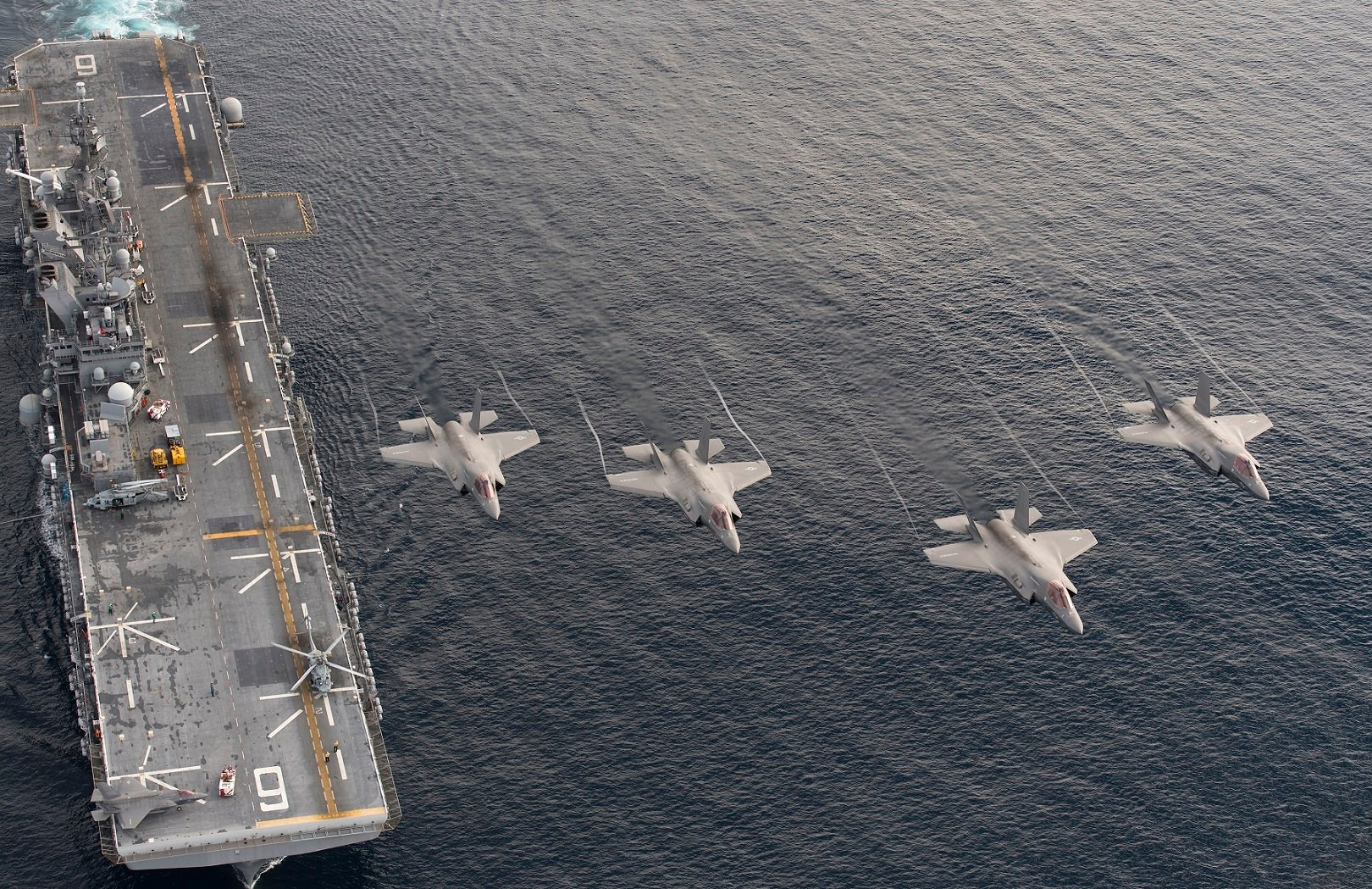 Four F-35B Lightning II aircraft perform a flyover above the amphibious assault ship USS America (LHA 6) on Nov. 20, 2016. US Navy Photo