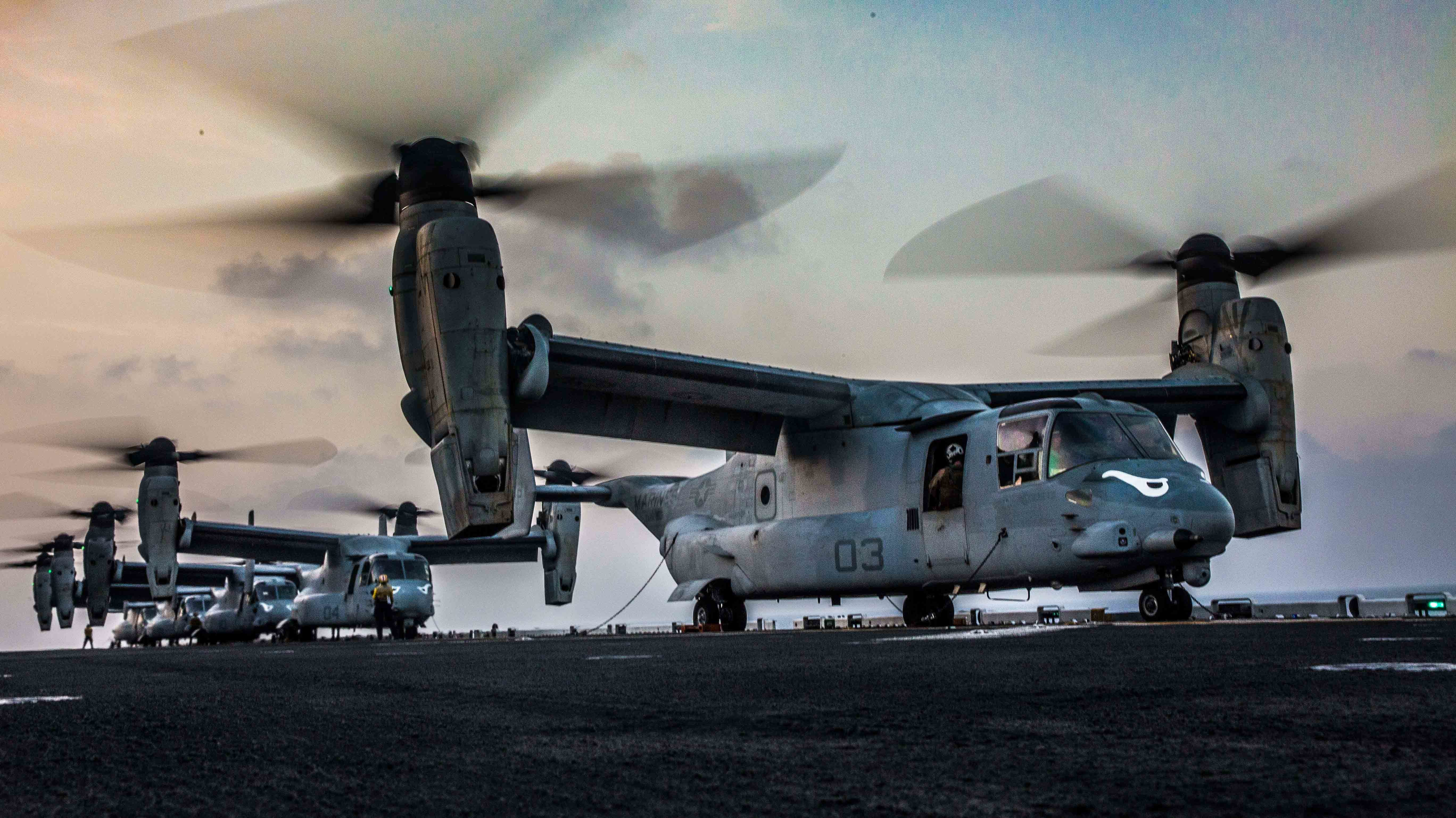 U.S. Marine MV-22 Ospreys, assigned to the Ridge Runners of Marine Medium Tiltrotor Squadron 163 (Reinforced), prepare to takeoff from the flight deck of the amphibious assault ship USS Makin Island (LHD 8) in support of a helo-borne raid during Exercise Alligator Dagger, in the Gulf of Aden, Dec. 21, 2016. US Navy photo.