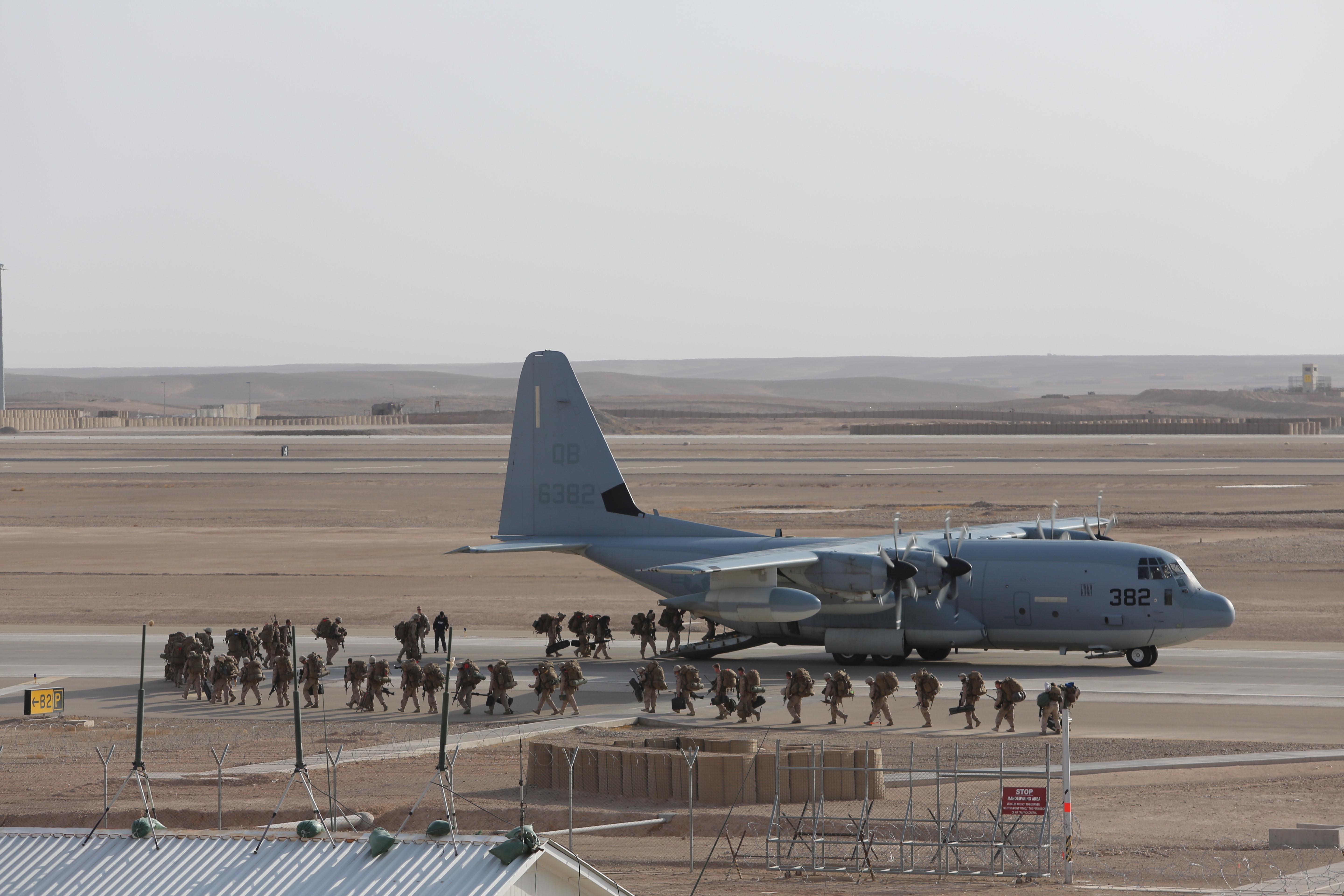 U.S. Marines with Regional Command (Southwest) (RC(SW)) board a KC-130 Hercules aircraft to depart the Bastion-Leatherneck Complex in Helmand province, Afghanistan October 27, 2014. The Marines departed following the end of RC(SW) operations in Helmand province. US Marine Corps photo.