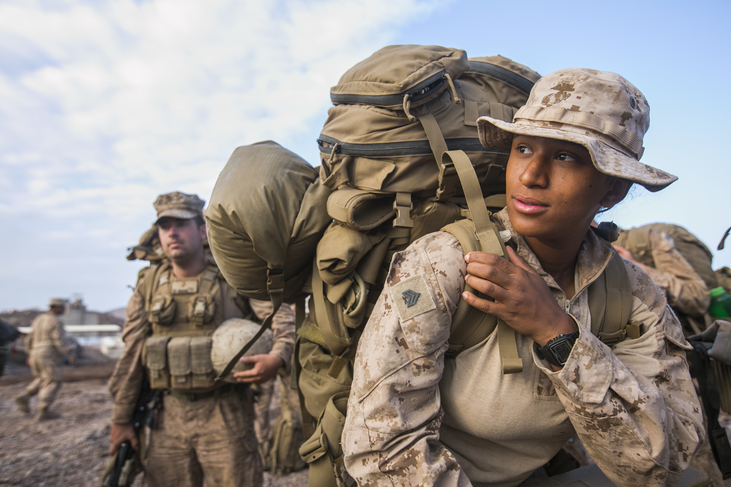 ARTA BEACH, Djibouti (Dec. 20, 2016) U.S. Marine Corps Sgt. Summer Forcier, an ammunition technician with Combat logistics Battalion 11, 11th Marine Expeditionary Unit (MEU), dons her pack and prepares to embark a landing craft utility during exercise Alligator Dagger at Arta Beach, Djibouti, Dec. 20. The unilateral exercise provides an opportunity for the Makin Island Amphibious Ready Group and 11th MEU to train in amphibious operations within the U.S. 5th Fleet area of operations. The 11th MEU is currently supporting U.S. 5th Fleet's mission to promote and maintain stability and security in the region. (U.S. Marine Corps photo by Sgt. Xzavior T. McNeal)