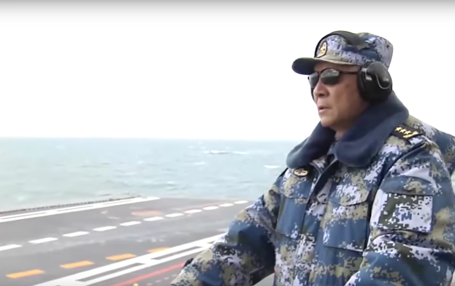 The head of the People's Liberation Army Navy Adm. Wu Shengli on Chinese carrier Liaoning