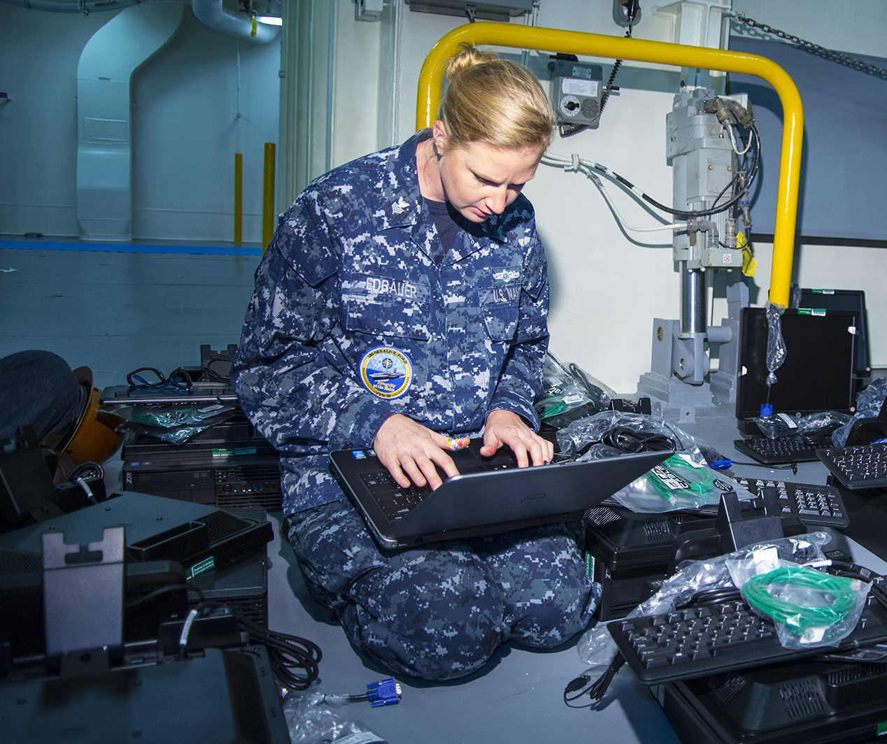 Information Systems Technician 1st Class Heather Edbauer assigned to Gerald R. Ford (CVN 78), track inventory while issuing new network computers for shipboard offices on July 14, 2015. US Navy Photo