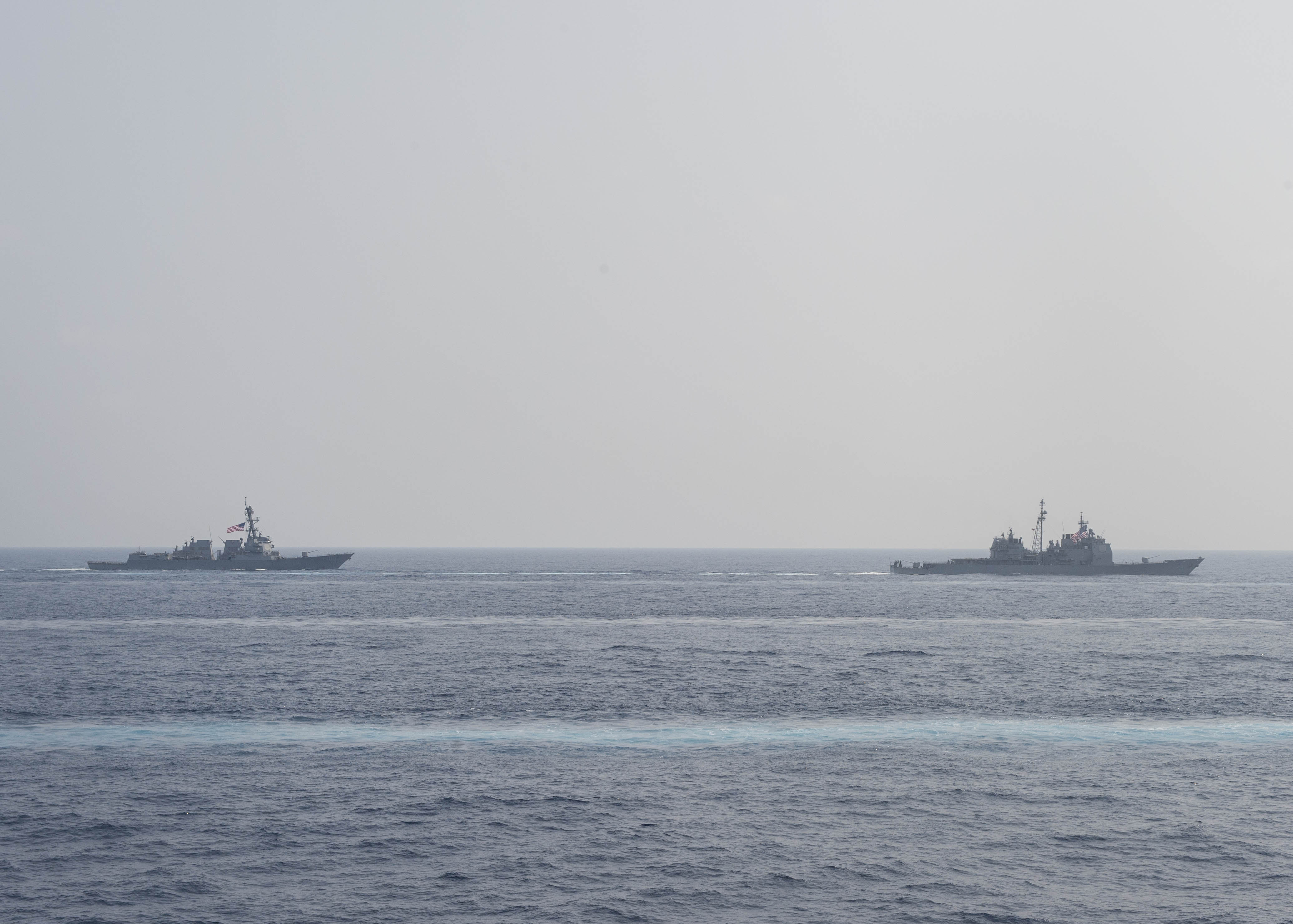 The guided-missile cruiser USS Mobile Bay (CG 53), right, and the guided-missile destroyer USS Stockdale (DDG 106) transit together in the Philippine Sea in March 2016. US Navy photo.
