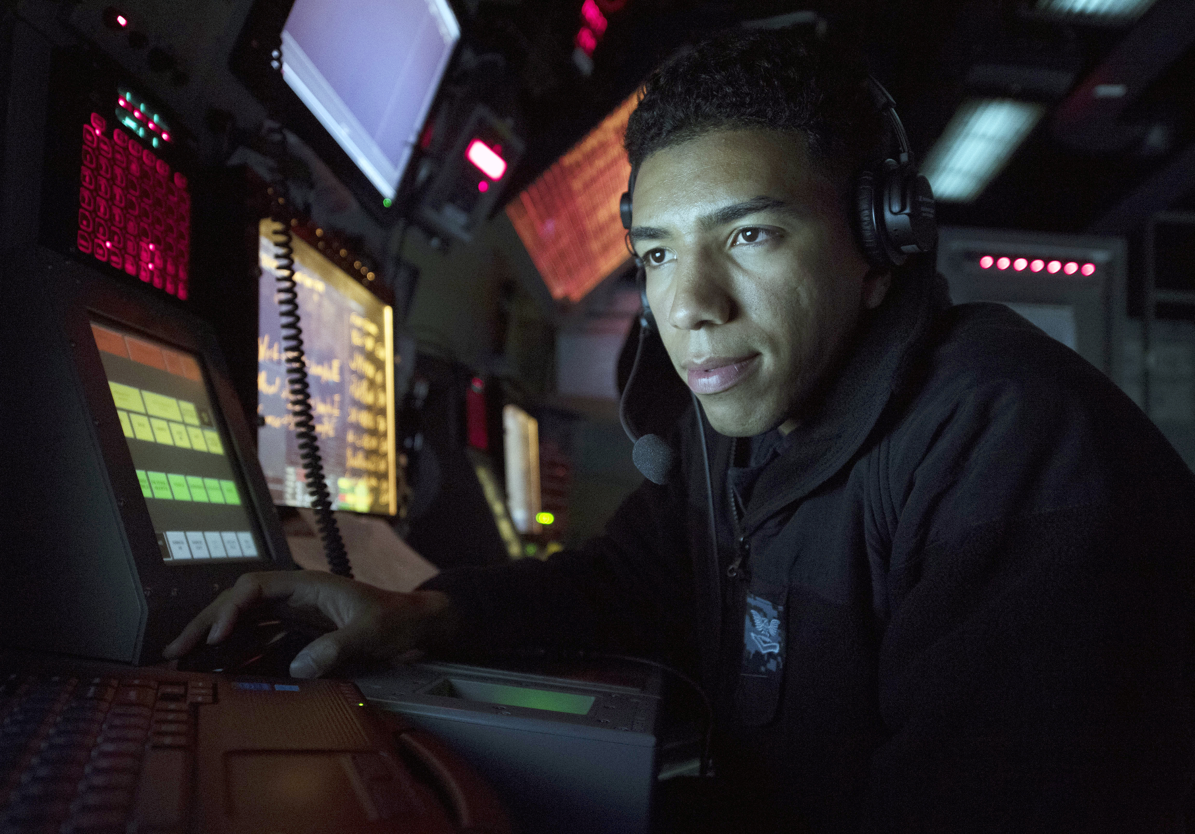 Cryptologic Technician (Technical) 2nd Class Jonathan Morel, assigned to USS Michael Murphy (DDG-112), uses a radar tracking system to track surface contacts on Jan. 30, 2017. US Navy Photo