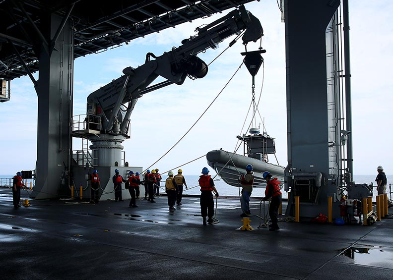 Sailors and Civil Service Mariners attached Military Sealift Command's expeditionary mobile base, USNS Lewis B. Puller (T-ESB 3), recover a Rigid-Hull Inflatable Boat (RHIB), May 16, 2016. MSC Photo