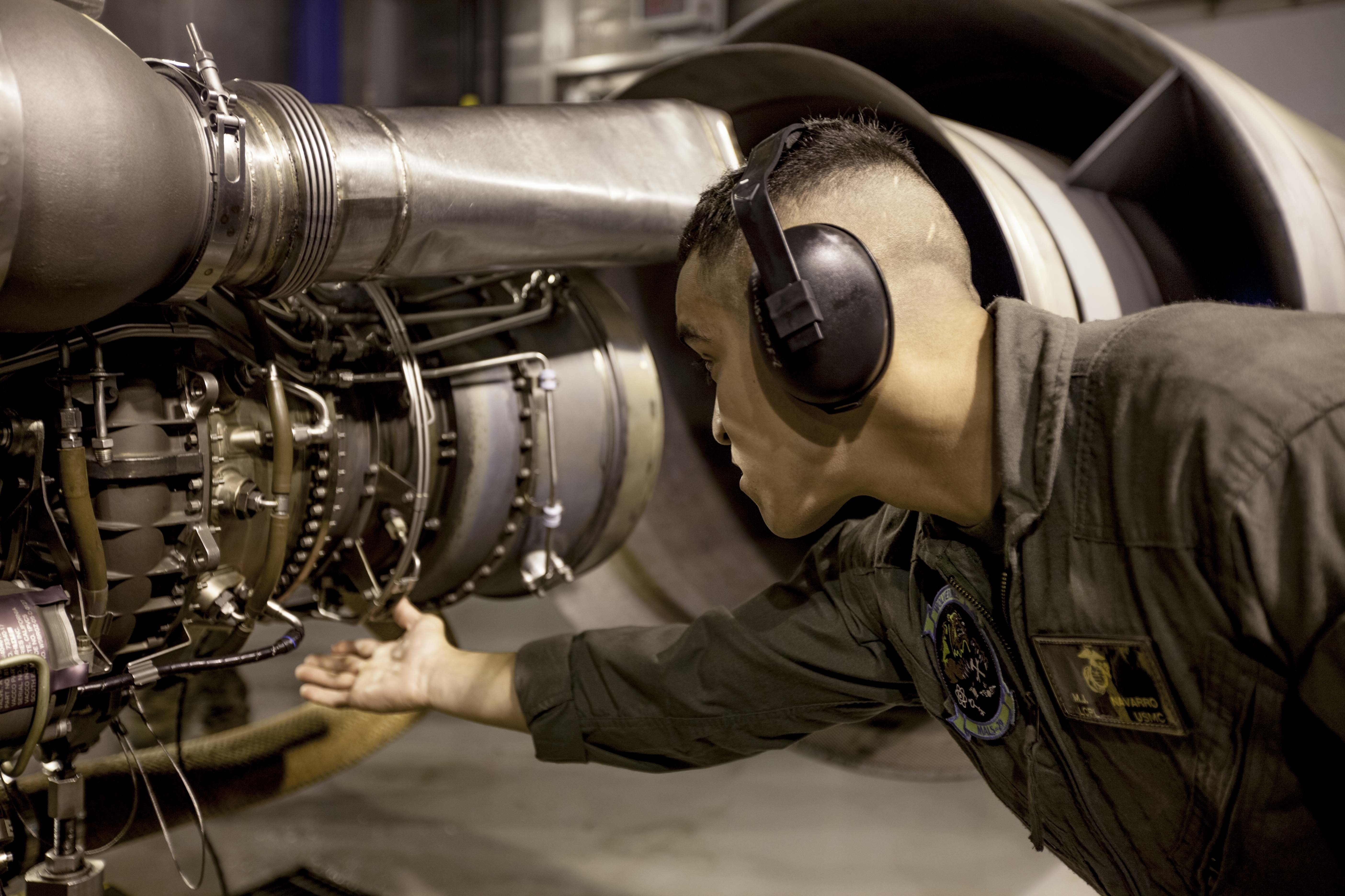 U.S. Marine Corps Lance Cpl. Manuel J. Navarro, a helicopter power plant mechanic assigned to Marine Aviation Logistics Squadron (MALS) 29, checks an AH-1W Super Cobra and a UH-1Y Venom engine for fluid and air leaks aboard Marine Corps Air Station New River, N.C., Oct 18, 2016. MALS-29's mission is to provide aviation logistics support, guidance, planning, and direction to other squadrons within the Marine Aircraft Group, as well as logistics support for Navy funded equipment in the supporting Marine Wing Support Squadron, Marine Air Control Group, and Marine Aircraft Wing/Mobile Calibration Complex. US Marine Corps photo.