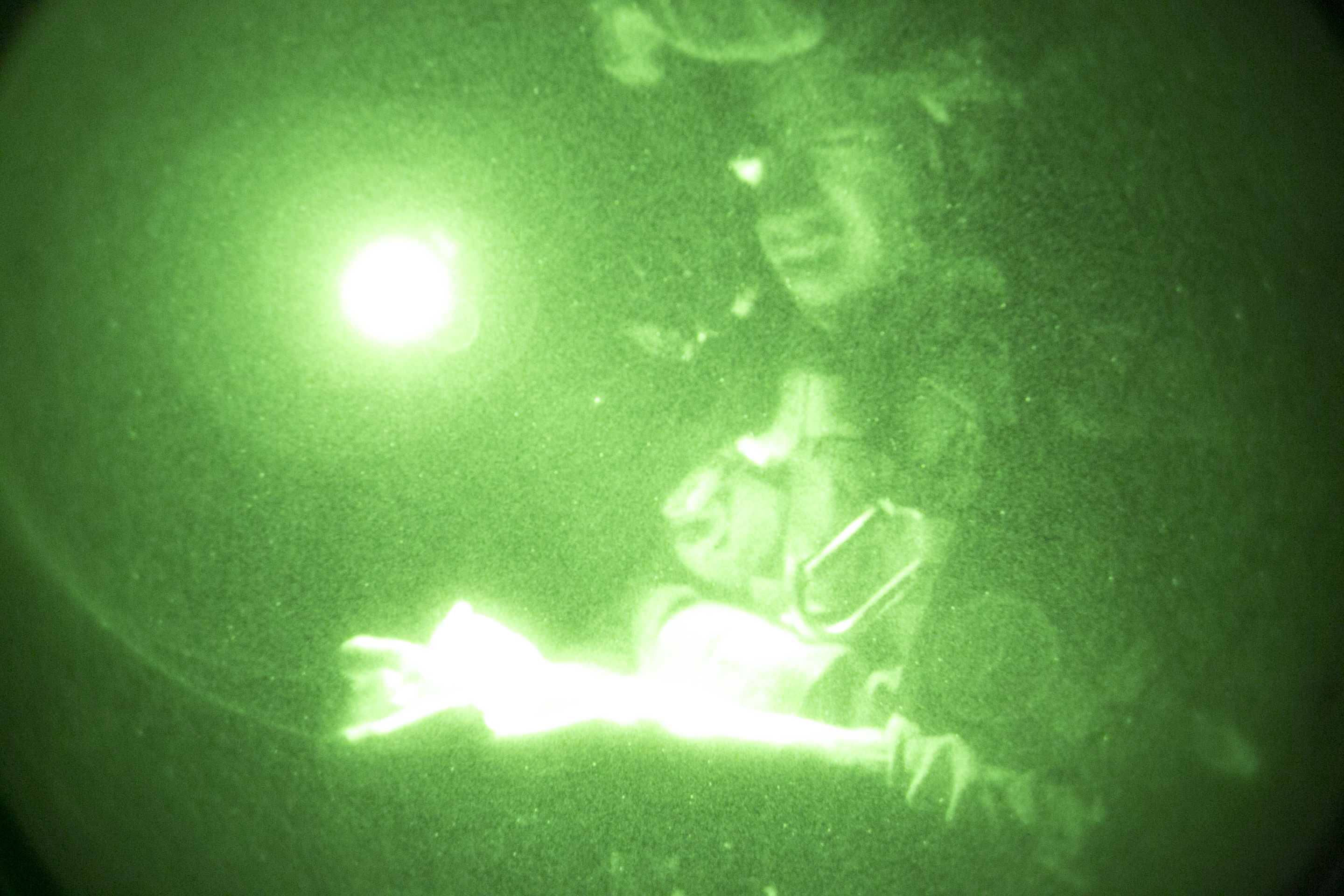 A U.S. Marine with Battalion Landing Team, 1st Battalion, 4th Marines, 11th Marine Expeditionary Unit (MEU), reviews a map while conducting a night raid during Exercise Alligator Dagger near Arta, Djibouti, Dec. 21, 2016. US Marine Corps