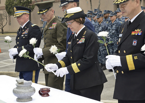 Rear Adm. Lisa Franchetti, then commander of U.S. Naval Forces Korea lays a flower during a March 25, 2015 remembrance service in Seoul, South Korea, honoring sailors lost in the 2010 sinking of the ROKS Cheonan (PCC-772) after being struck by a North Korean torpedo. The lives of 46 sailors onboard were lost along with a Republic of Korea navy diver who died during the subsequent rescue efforts. (U.S. Navy Photo)