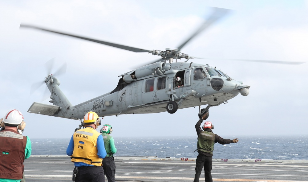 An MH-60S Seahawk helicopter is launched from the flight deck of USS Gerald R. Ford (CVN-78). (U.S. Navy photo)