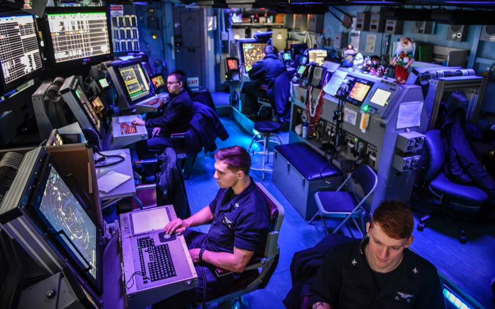 Sailors control aircraft on deck inside of carrier air traffic control center aboard the aircraft carrier USS Theodore Roosevelt (CVN-71). (U.S. Navy photo)
