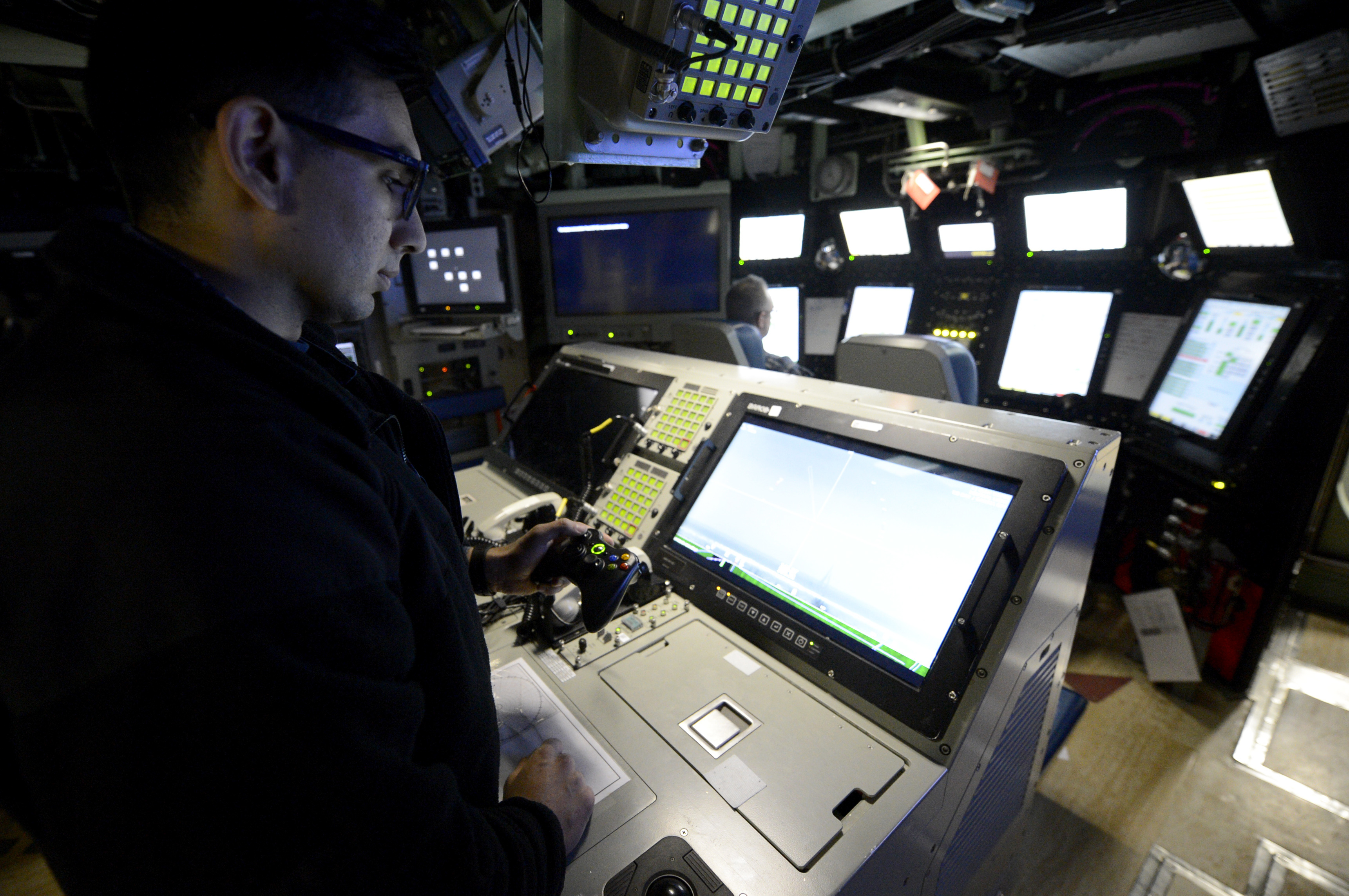 Lt. Anthony Matus uses an Xbox controller to maneuver the photonic mast aboard the USS Colorado (SSN-788). (Navy photo)