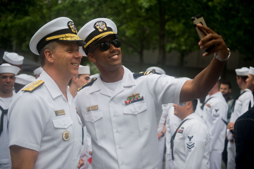 Adm. Phil Davidson takes a selfie with a sailor during Fleet Week New York 2017.
