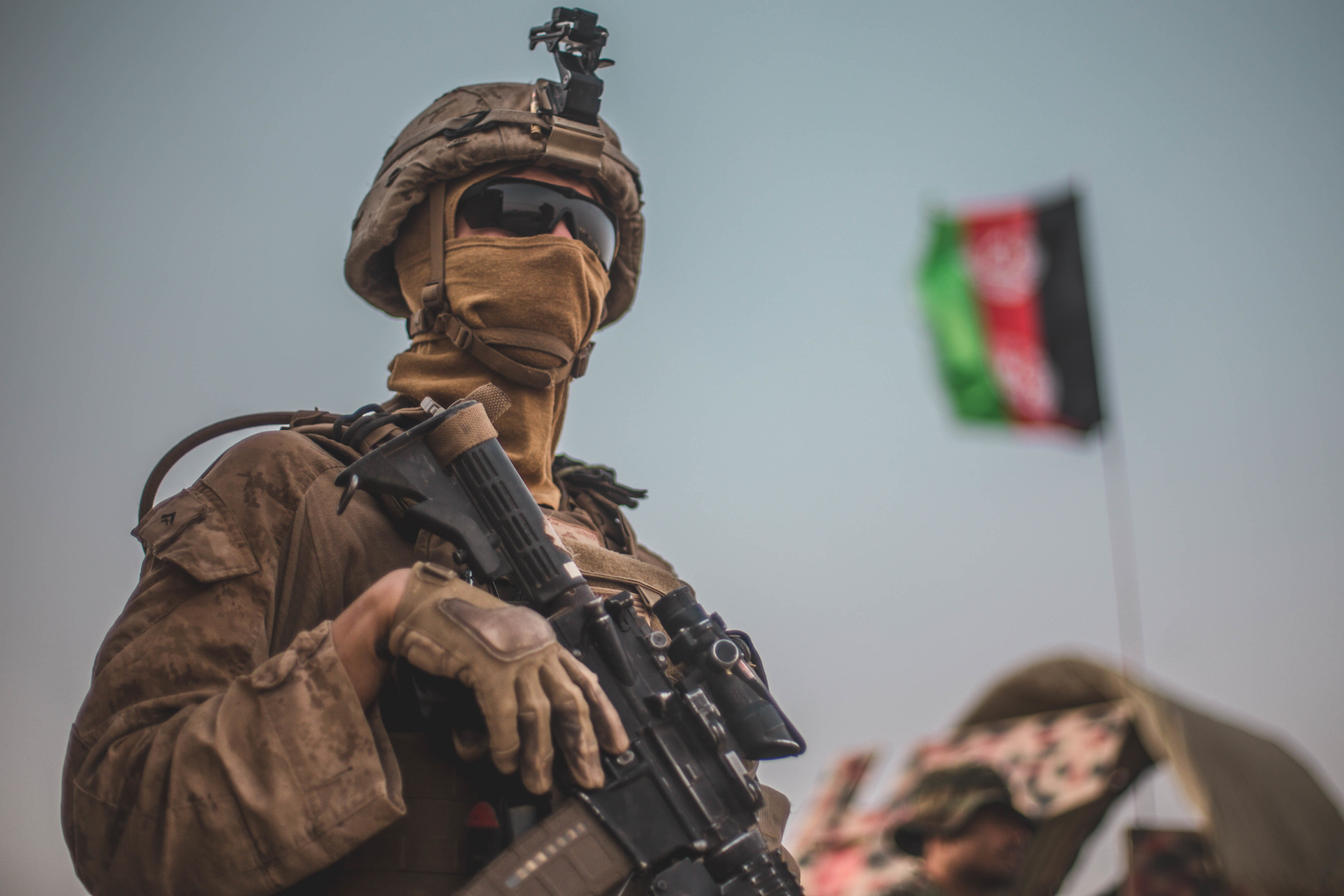 a us marine with task force southwest tfsw provides security for marine advisors during an advising mission with 1st brigade afghan national army ana