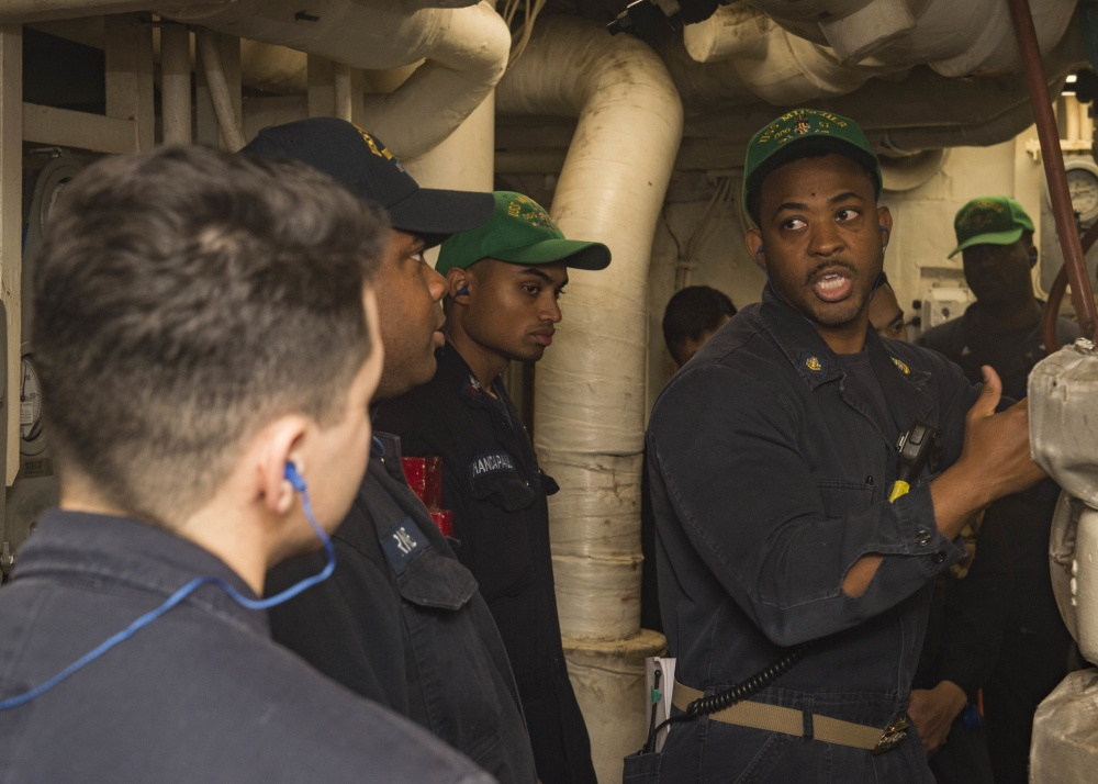 Senior Chief Gas Turbine Systems Technician (Mechanical) Brady Carmack instructs Sailors aboard the Arleigh Burke-class guided-missile destroyer USS Mitscher (DDG 57) during engineer training drills, Oct. 3, 2017. US Navy photo.