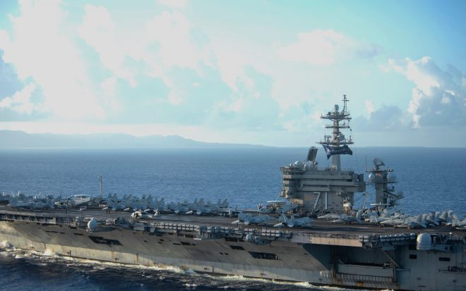 USS Theodore Roosevelt Back in Guam Picking up Remaining Sailors Before Resuming Deployment
